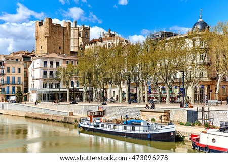 Narbonne, France - April 8, 2016: The Canal de la Robine and The Cathedral of Saint-Just and Saint-Pasteur, is a former cathedral, national monument of France, located in the town of Narbonne. France
