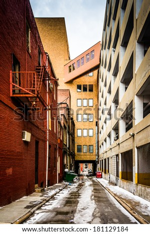 Narrow alley and parking garage in Baltimore, Maryland. - stock photo