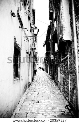 Narrow alley in Rovinj, Croatia - stock photo