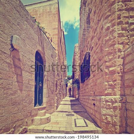 Narrow Alley in the Armenian Quarter of Jerusalem, Retro effect - stock photo