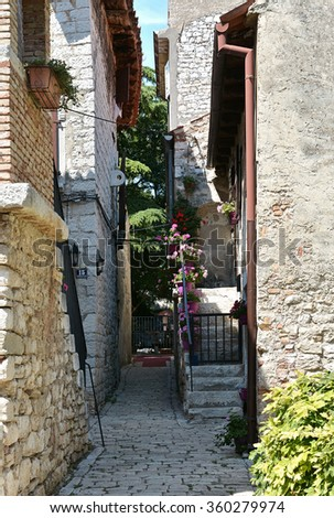 narrow alley in the old town of Porec in Croatia - stock photo