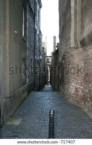 Narrow alley on Edinburghs Royal mile. - stock photo