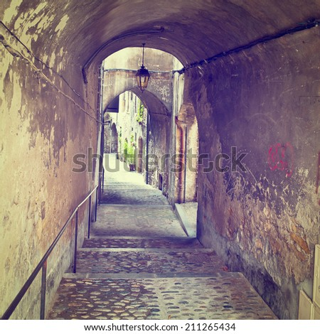 Narrow Alley with Old Buildings in French City of Crest,  - stock photo