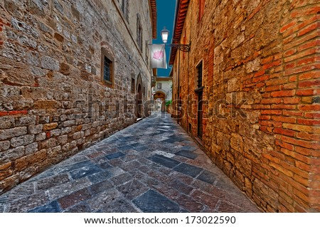 Narrow Alley with Old Buildings in Italian City at Midnight - stock photo