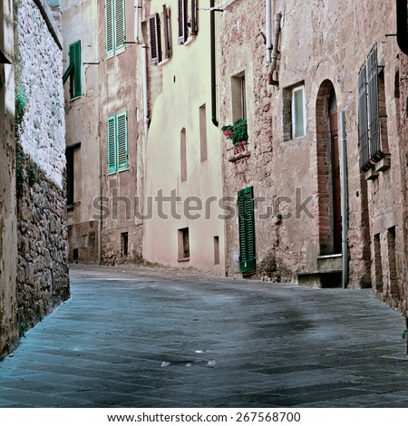 Narrow Alley with Old Buildings in Italian City of Volterra, Vintage Style Toned Picture - stock photo