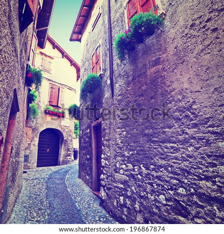 Narrow Alley with Old Buildings in Italian City, Retro Effect - stock photo