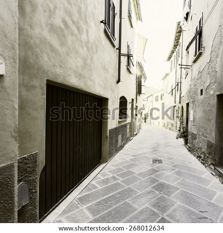 Narrow Alley with Old Buildings in Italian City, Vintage Style Toned Picture - stock photo