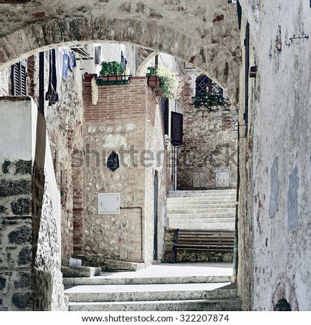 Narrow Alley with Old Buildings in Italian City, Vintage Style Toned Picture