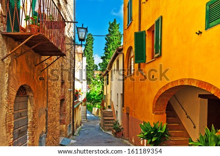 Narrow Alley with Old Buildings in the Italian City - stock photo