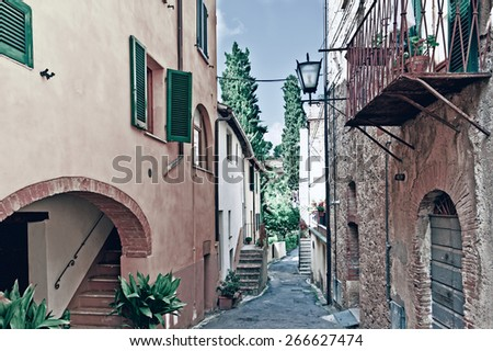 Narrow Alley with Old Buildings in the Italian City, Vintage Style Toned Picture - stock photo