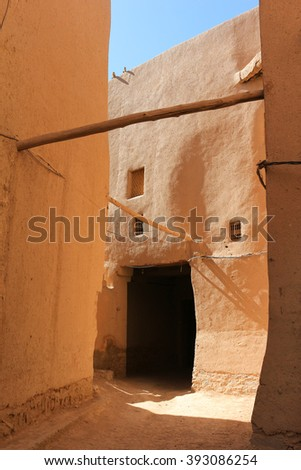 Narrow alleyways with coloruful clay walls of the ksar in Rissani, Morocco