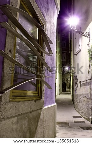 Narrow and dark alley in the historical center of Trieste, Italy