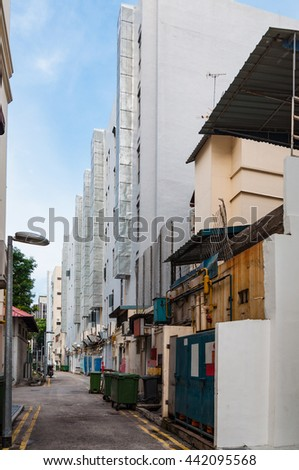 narrow back alley in Singapore city, grunge aged street