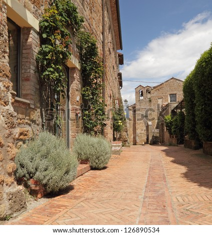 narrow brick street in tuscan small town, borgo Sovana, Tuscany, Italy, Europe - stock photo