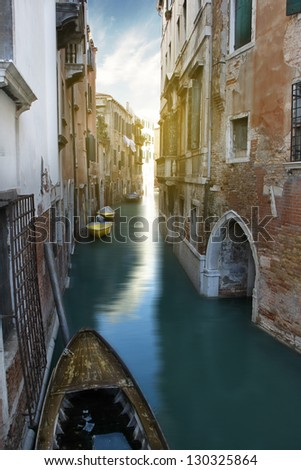 Narrow Canal and gondola, Venice, Italy.