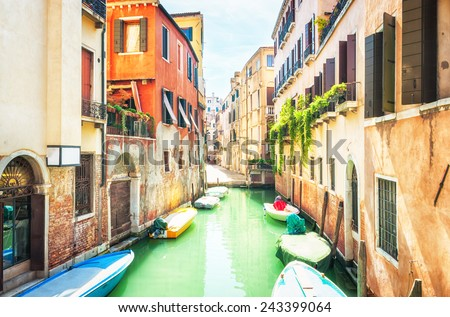 Narrow canal and old buildings in Venice, Italy. - stock photo