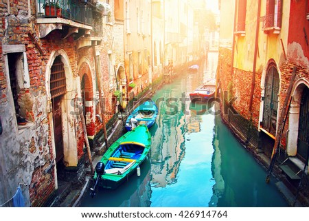 Narrow canal in Venice, Italy. Famous touristic place.  - stock photo