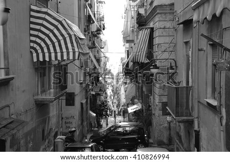 narrow city street with markets from top view in naples spanish quarter in italy