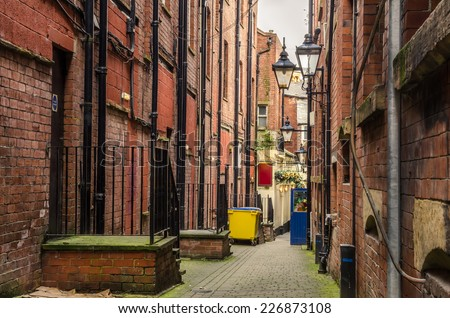 Narrow Cobbled Alley in Leeds City Centre - stock photo
