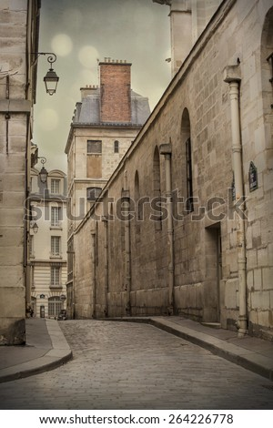 Narrow cobblestone street in Paris, France - stock photo