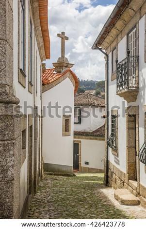 Narrow cobblestoned street in historical town Amarante, Portugal - stock photo