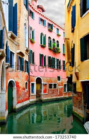 Narrow curved canal in Venice, Italy