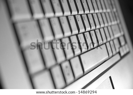 Narrow DOF focus on grey laptop keyboard - stock photo