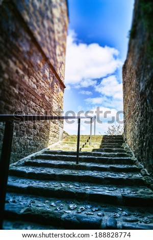 Narrow european street with staircase - stock photo