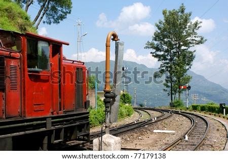 Narrow gauge railway for Himalayan Queen train in Himalayas, India - stock photo