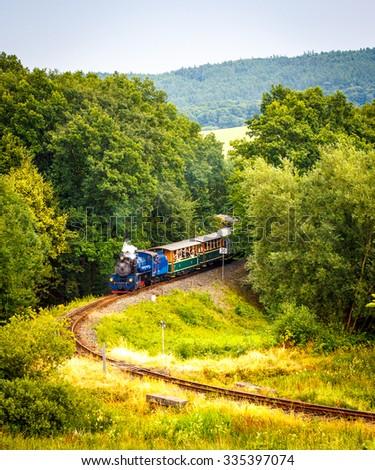 Narrow-gauge steam train  - stock photo
