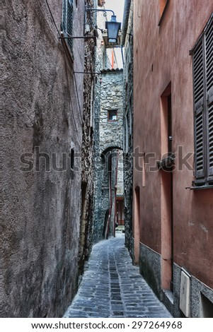 Narrow medieval street in France. Toned - stock photo