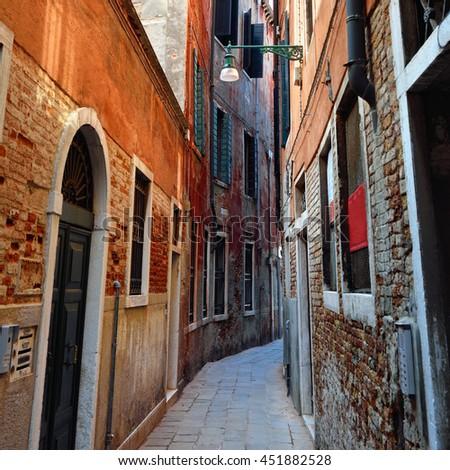 Narrow medieval street in historic part of Venice, Italy - stock photo