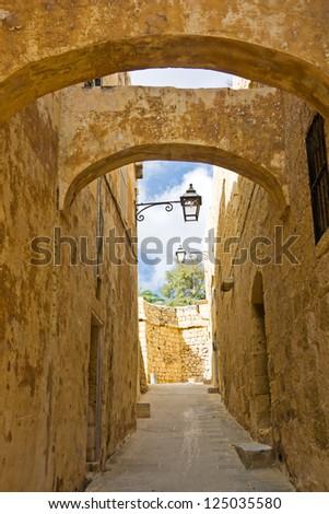 Narrow medieval street in the citadel of Gozo, Malta - stock photo