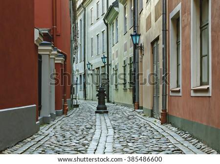 Narrow medieval street in the old Riga city, Latvia - stock photo