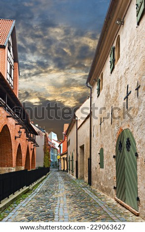 Narrow medieval street in the old Riga city, Latvia. In 2014, Riga is the European capital of culture
