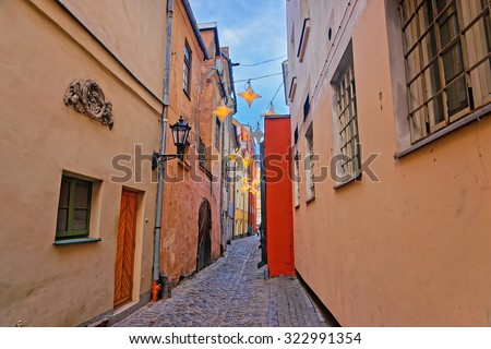 Narrow medieval streets of Old Riga decorated for Christmas - stock photo