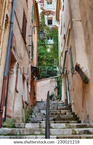 Narrow old street at night in the old town Cannes, France - stock photo