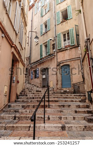 Narrow old street in the old town Cannes, France