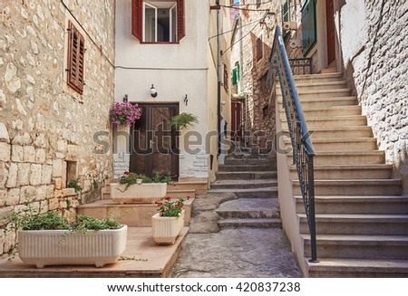 Narrow old streets and yards in Sibenik city, Croatia, medieval zone - stock photo