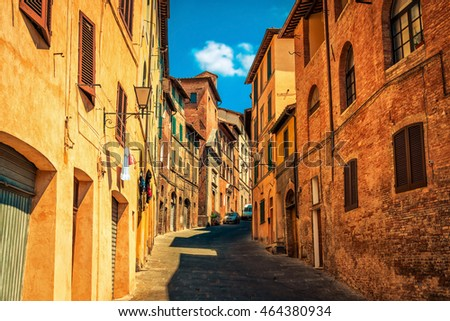 Narrow old streets in medieval Siena city, Tuscany region, Italy.