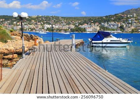 Narrow planks cover the deck in Porto Rafti harbor, Greece - stock photo