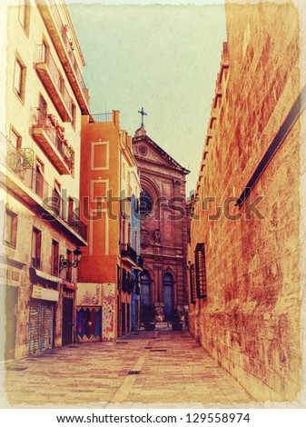 Narrow spanish street. Photo in old image style.