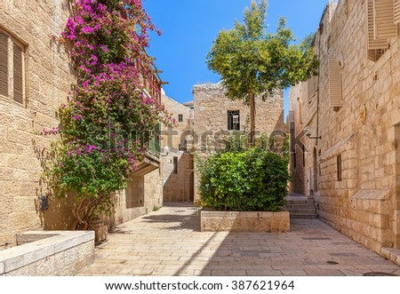 Narrow street among typical houses at Jewish Quarter in Old City of Jerusalem, Israel. - stock photo