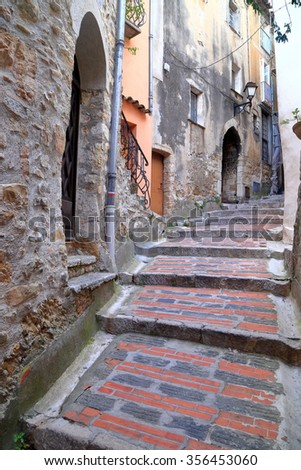 Narrow street and historical buildings in Roquebrune Cap Martin, French Riviera, France