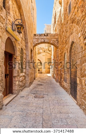 Narrow street and typical stoned houses of jewish quarter in Old City of Jerusalem, Israel.