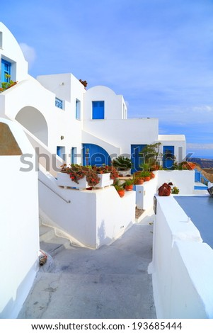 Narrow street and white buildings on the island of Santorini, Greece