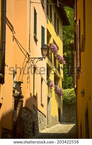 narrow street at Bellagio village, Como lake, Italy - stock photo