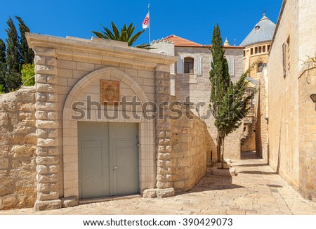 Narrow street between ancient walls and convent of San Francisco in Old City of Jerusalem, israel.