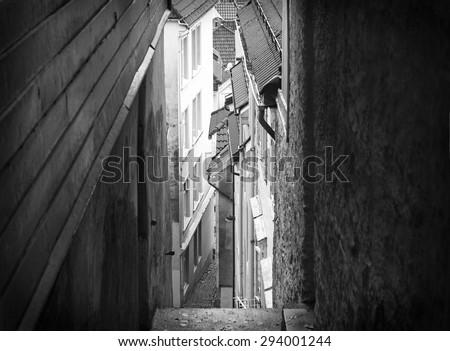 Narrow street between houses in Bergen, Norway - stock photo