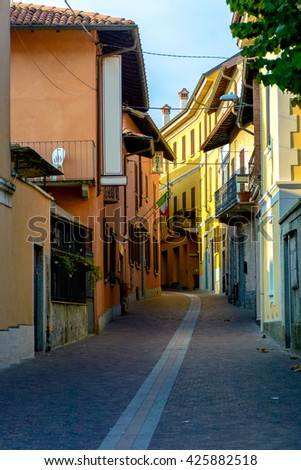 Narrow street between italian houses in old town of Angera,Italy. - stock photo